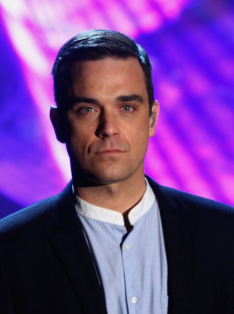 Robbie Williams in a suit