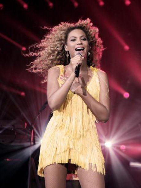 Beyonce wears a yellow dress at the launch of album '4' in Shepherd's Bush empire