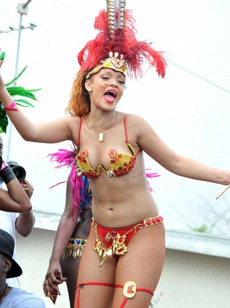 red and gold number 2 rihanna rihanna parties hard at the barbados ... Rihanna Songs