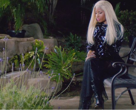 nicki wears a patented leather jacket for this quiet scene