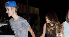 Justin Bieber and Selena Gomez holding hands
