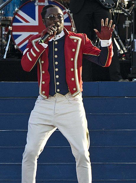 Will.i.am performing live dressed in military garb.