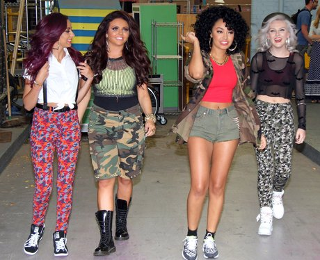 Little Mix wearing camoflage outfits