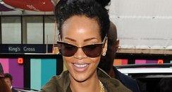 Rihanna arrives at St pancras station smiling