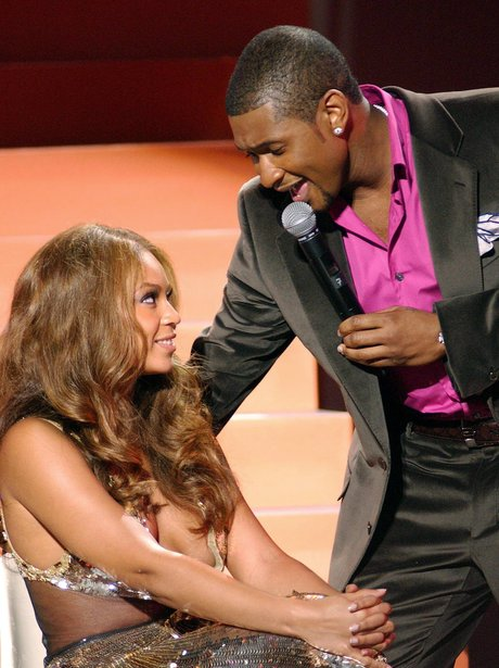 Beyonce Knowles and Usher on stage