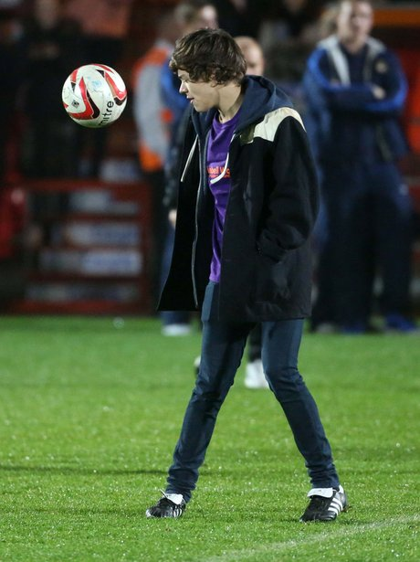 Harry Styles playing football