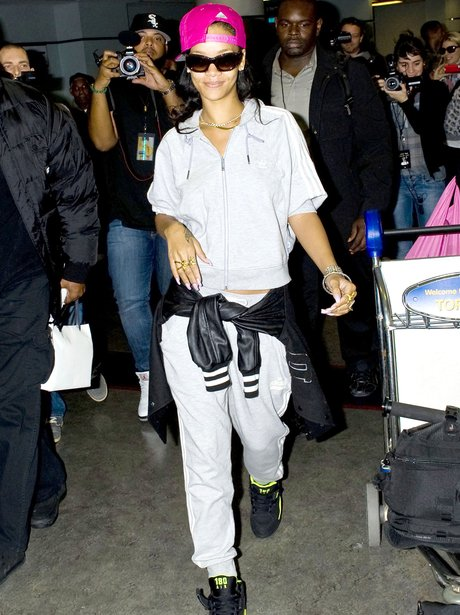 Rihanna arrives at Toronto International Airport wearing a tracksuit