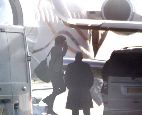 Harry Styles arrives in London with Taylor Swift