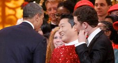PSY shakes hands with president Barack Obama