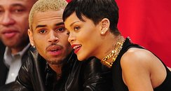 Rihanna and Chris Brown watching basketball togeth