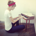 Image 5: Taylor Swift playing a small piano