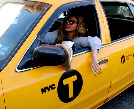 Beyonce in a yellow taxi
