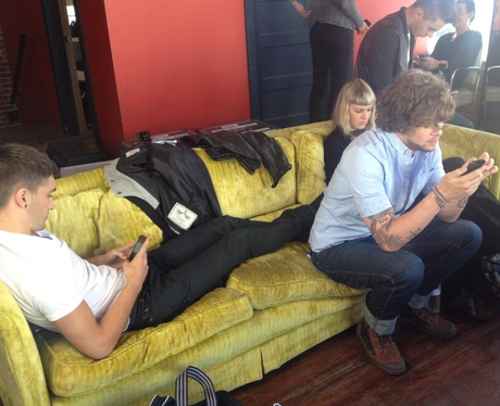 The Wanted on their phones in LA