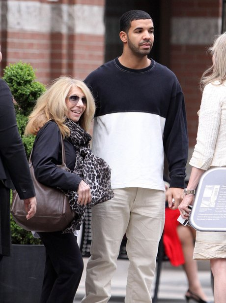 Drake with an arm around his mum