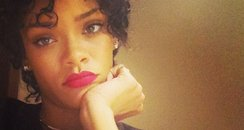 Rihanna with new hair and red lipstick