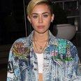 Miley Cyrus wearinh hotpants