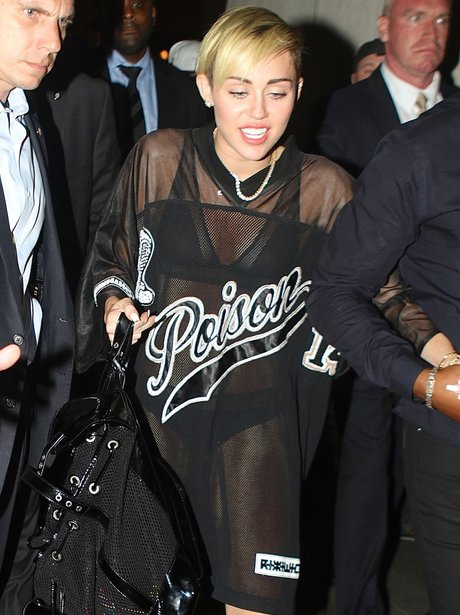 Miley Cyrus wearing a see-through dress