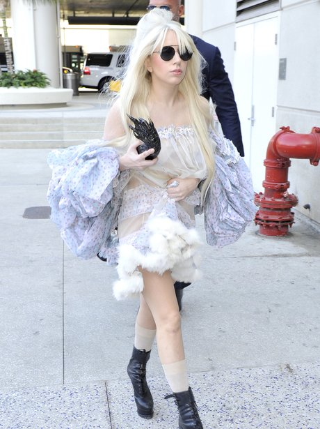 Lady Gaga at Lax Airport with a Claw Halloween bag