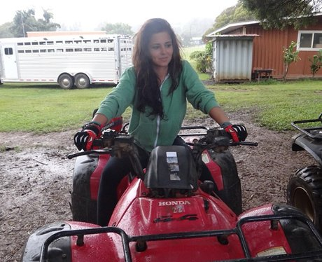 Cheryl Cole on a sit-on tractor