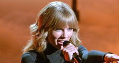 Taylor Swift performs on the X Factor