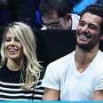 Mollie King and David Gandy watching tennis