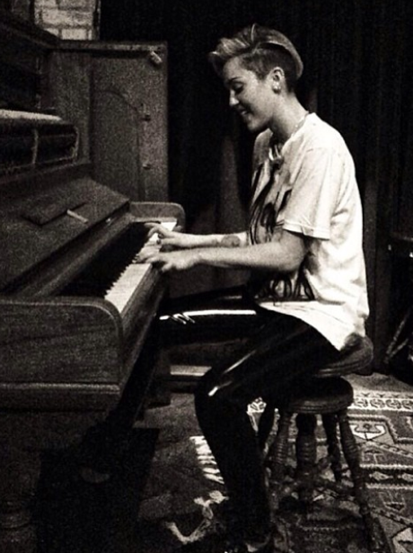 Miley Cyrus playing the piano