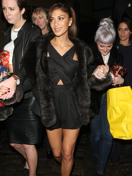 Nicole Schezinger wearing a black cut out dress