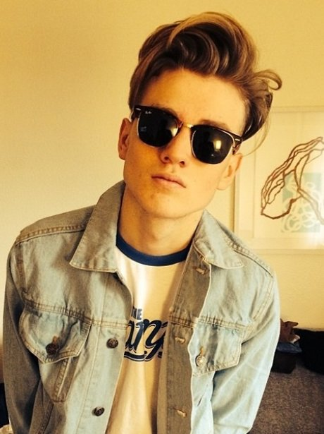 Tristan from The Vamps poses in dark shades