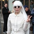 Lady Gaga wearing a white suit wiht a long whiite