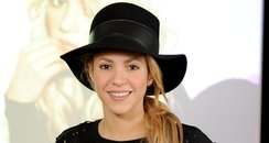 Shakira in a black hat