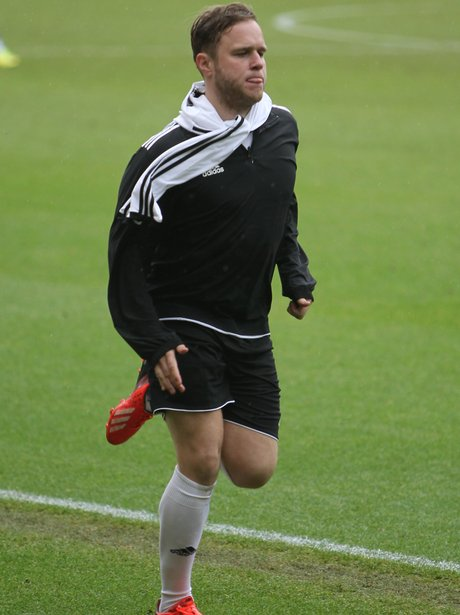 Olly Murs playing football