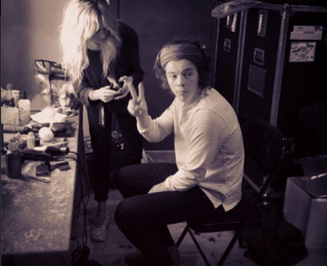 Harry Styles posing backstage