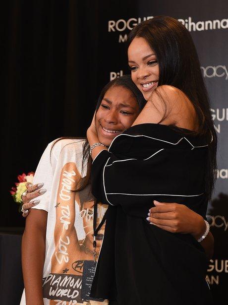 Rihanna hugs a crying fan