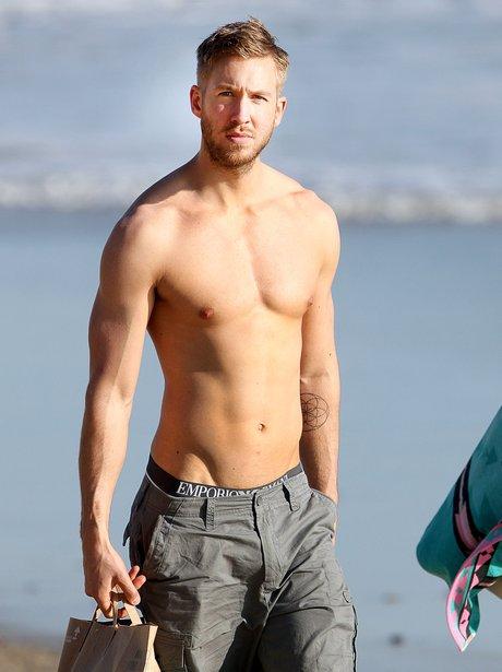 Calvin Harris topless on the beach