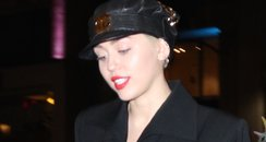 Miley Cyrus wearing a black suit
