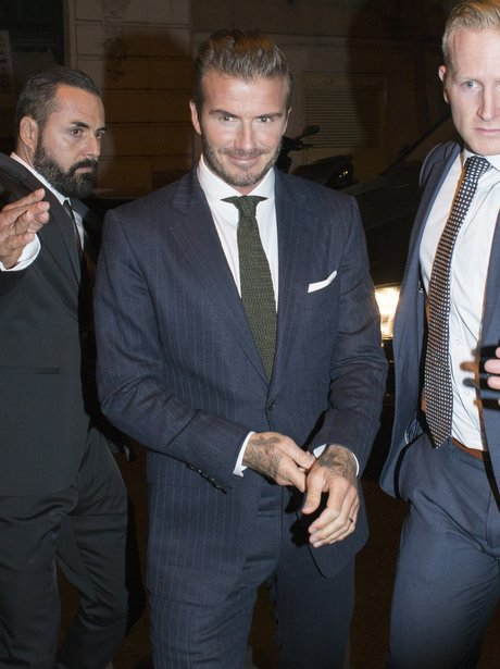 Davud beckham wearing a suit